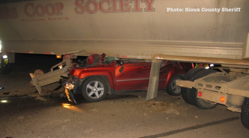 Woman requires extracation from SUV after crashing into feed trailer