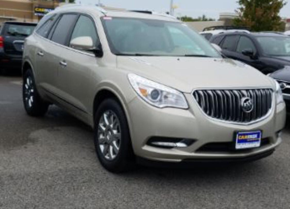 STOLEN Tan 2011 Buick Enclave from South Sioux City