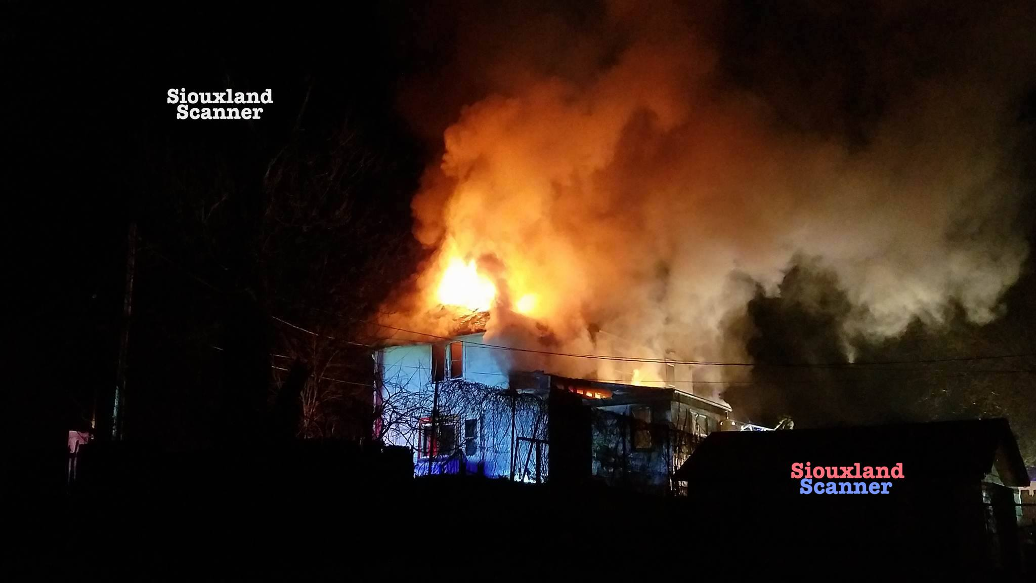 20 foot flames could be seen from burning West Side home Sunday Morning